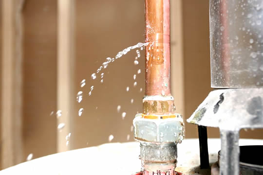 Leaky water heater before being repaired